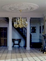 Ann De Silva has used columns to enhance this beautiful hallway and staircase