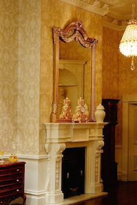 Georgian elegance with the yellow wallpaper enhances the PF9 and OM9 fireplace set set