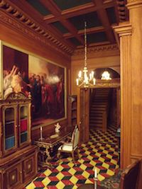 Giac DellAccio had created this wonderful wood lined and carved room. The C18 coving has been stained to look like wood